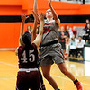 Don Knight | The Herald Bulletin<br /> Anderson University's Payton Moore drives into the lane against a pair of  Rose-Hulman defenders on Wednesday.