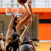 Don Knight | The Herald Bulletin<br /> Anderson University's Hannah Hawkins draws a foul from Rose-Hulman's Hannah Woody on Wednesday.