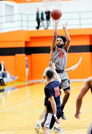 Don Knight   The Herald Bulletin<br /> Anderson University's DeVante Mayes shoots as the Ravens hosted Hope College on Saturday.