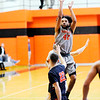 Don Knight | The Herald Bulletin<br /> Anderson University's DeVante Mayes shoots as the Ravens hosted Hope College on Saturday.