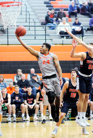 Don Knight | The Herald Bulletin<br /> Anderson University's Ronny Williams lays up a basket at the end of the first half as the Ravens hosted Hope College on Saturday.