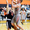 Don Knight | The Herald Bulletin<br /> Anderson University's Cole Hartman draws a foul from Hope's Preston Granger on Saturday.