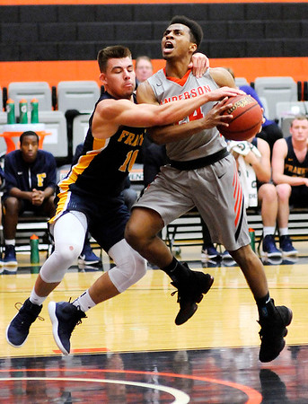 Don Knight   The Herald Bulletin<br /> Franklin's Jordan Anderson fouls Anderson University's Ronny Williams after Williams stole the ball and broke for the basket on Wednesday. Anderson was called for a flagrant 1 foul.