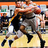 Don Knight | The Herald Bulletin<br /> Franklin's Jordan Anderson fouls Anderson University's Ronny Williams after Williams stole the ball and broke for the basket on Wednesday. Anderson was called for a flagrant 1 foul.