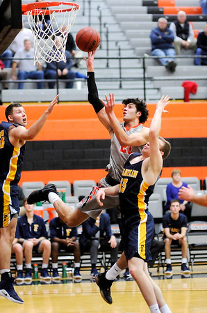 Don Knight | The Herald Bulletin<br /> Anderson University's Maurice Knight drives to the basket as the Ravens hosted the Franklin College Grizzlies on Wednesday.