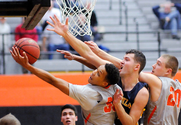 Don Knight | The Herald Bulletin<br /> Anderson University's Malik Laffoon grabs an offensive rebound as the Ravens hosted the Franklin College Grizzlies on Wednesday.
