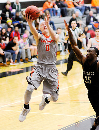 Don Knight | The Herald Bulletin<br /> Anderson University's Trevor Lucas drives for a layup as he is guarded by Defiance's Payton Ross on Wednesday.