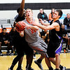 Don Knight | The Herald Bulletin<br /> Anderson University's Cole Hartman draws a foul from Defiance's Devin Mangas, right, as he drives into the lane on Wednesday.