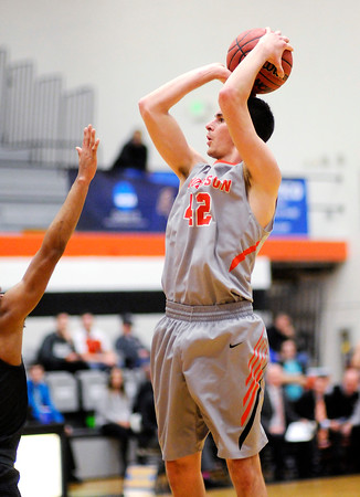 Don Knight   The Herald Bulletin<br /> Anderson University's Nathaniel Acree shoots as the Ravens hosted Marian on Wednesday.