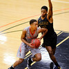 Don Knight   The Herald Bulletin<br /> Anderson University's Malik Laffoon drives into the paint against Marian's Curtis Green on Wednesday.