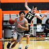 Don Knight | The Herald Bulletin<br /> Anderson University's Maurice Knight drives the baseline past Manchester's Nathan Carbaugh on Wednesday.