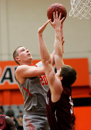 Don Knight | The Herald Bulletin<br /> Anderson University's Cole Hartman shoots over the outstretched arms of Rose-Hulman's Jacob Back on Wednesday.