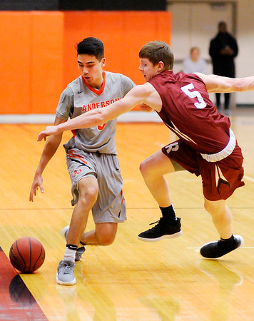 Don Knight   The Herald Bulletin<br /> Anderson University's Stanley Duncan draws a blocking foul from Rose-Hulman's Jacob Back as he dribbles down the sideline on Wednesday.