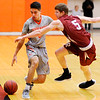 Don Knight | The Herald Bulletin<br /> Anderson University's Stanley Duncan draws a blocking foul from Rose-Hulman's Jacob Back as he dribbles down the sideline on Wednesday.