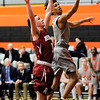 Don Knight | The Herald Bulletin<br /> Anderson University's Michael Rogers laysup a basket on a fast break as he is defended by Rose-Hulman's Michael Lake on Wednesday.