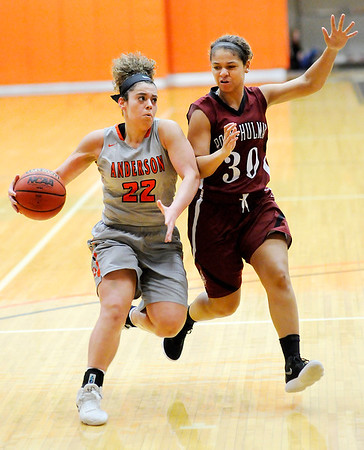 Don Knight | The Herald Bulletin<br /> Anderson's Ryana Watson drives as she is guarded by Rose-Hulman's Alyzia Dilworth on Wednesday.