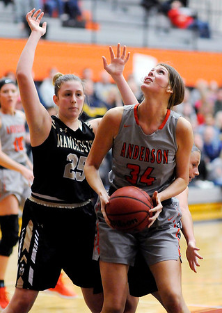 Don Knight   The Herald Bulletin<br /> Anderson University's Hannah Hawkins looks to shoot as she is guarded by Manchester's Macy Miller on Wednesday.