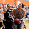 Don Knight | The Herald Bulletin<br /> Anderson University's Hannah Hawkins looks to shoot as she is guarded by Manchester's Macy Miller on Wednesday.