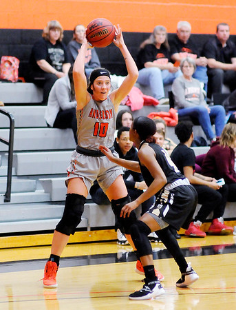 Don Knight | The Herald Bulletin<br /> Anderson University's Hanna Ault passes the ball as the Ravens hosted the Manchester Spartans on Wednesday.