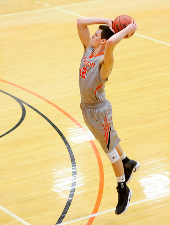 Don Knight | The Herald Bulletin<br /> Anderson University's Nathaniel Acree shoots from the three-point arc as the Ravens hosted Manchester on Wednesday.