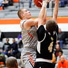 Don Knight | The Herald Bulletin<br /> Anderson University's Cole Hartman shoots after spinning around the defense of Manchester's Chase Casteel on Wednesday.