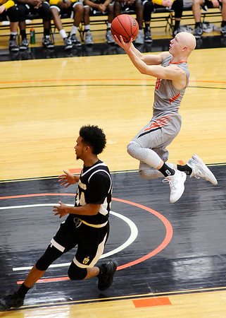 Don Knight   The Herald Bulletin<br /> Anderson University's Trevor Lucas soars into the lane ona fast break as the Ravens hosted Manchester on Wednesday.