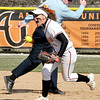 John P. Cleary | The Herald Bulletin<br /> Anderson University's Tara Morey reacts as the umpire calls the Trine runner out at second base after over running the base and getting picked off by Morey.