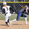 John P. Cleary | The Herald Bulletin<br /> Anderson University's Katy Johnson hits the bag at second then advances to third base on a throwing error on the play.