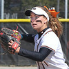 John P. Cleary | The Herald Bulletin<br /> Anderson University infielder Tara Morey eyes the runner as she throws to first base in the first game against Trine.