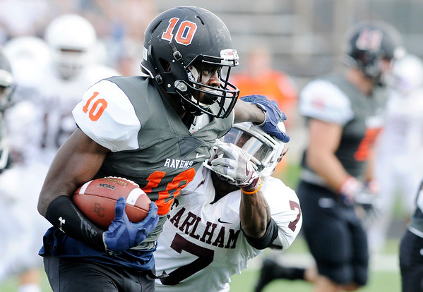 Don Knight | The Herald Bulletin<br /> Anderson's Deontae Kelly stiff arms Earlham's Marcaus Cooper on a kickoff return on Saturday.