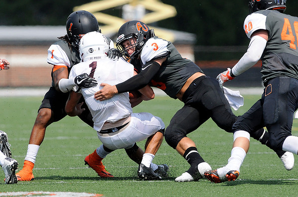 Don Knight | The Herald Bulletin<br /> Anderson's Kreevon Maple (1) and Wyatt Schebler (3) tackle Earlham quarterback Wes Hundley on Saturday.