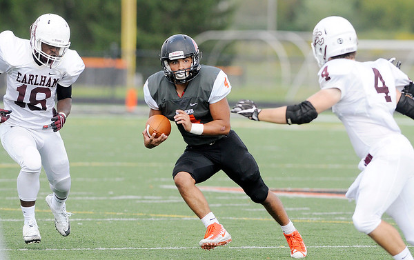 Don Knight | The Herald Bulletin<br /> Anderson's Johnny Ovalle carries the ball as the Ravens hosted the Earlham Quakers on Saturday.