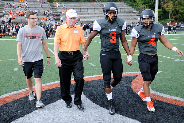 Don Knight | The Herald Bulletin<br /> Carter Byfield was a honorary captain for the coin toss as Anderson hosted Earlham on Saturday. Byfield was part of the first Ravens football team in 1947.