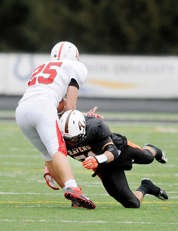 Don Knight | The Herald Bulletin<br /> Anderson University's Nate Moser tackles Hanover's Nate Hein<br /> during AU's homecoming on Saturday.