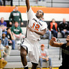 AU's Jamares McCloud drives for a layup as the Ravens hosted Manchester on Wednesday.