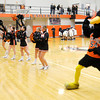 The Anderson University Raven and cheerleaders cheer as AU's starters are introduced as the Ravens hosted Manchester on Wednesday.