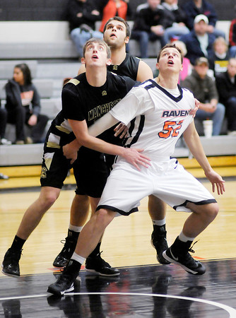 AU's Carson Breckenridge blocks out Manchester's Brady Dolezal on Wednesday.