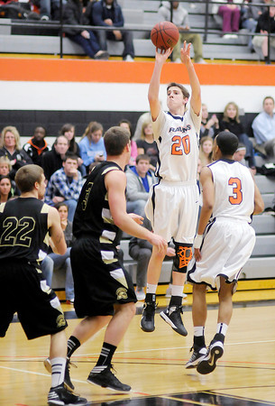 AU's Adam Miller shoots as the Ravens hosted Manchester on Wednesday.