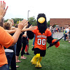 AU's raven mascot gets high-fives from fans as they wait for the team to make their entrance into Macholtz Stadium to open the 2012 football season.