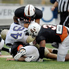 AU's defense gang tackles Taylor tight end Matt Luckman after a completed pass to him.