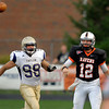 AU's quarterback, #12 Colton Priser lets the ball go on a run out while being pursued by Taylor's Joe Yanaitis.