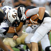AU's quarterback Colton Priser gets wrapped up around the neck by Taylor's Jordan Bradford.