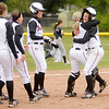 The Ravens celebrate Kelly Rusterholz's game winning RBI.