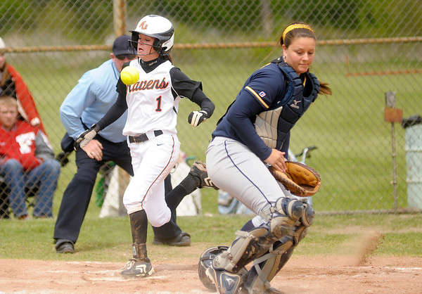 Anderson's Katie Lee scores a run for the Ravens as the ball gets past Franklin catcher Kim Holzbog in the second game of a double header on Saturday.