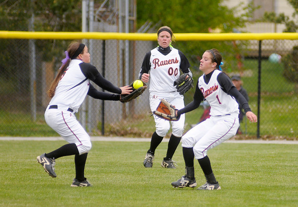 Natalie Moorhouse, left, and Katie Lee converge on a fly ball.
