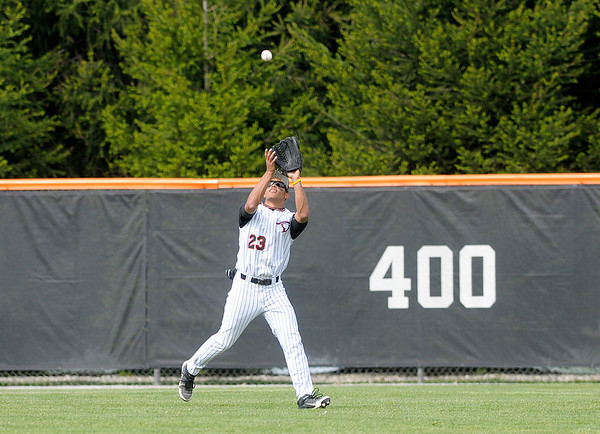 Anderson University's Jacob Craft catches a fly ball in the outfield as the Ravens hosted the Manchester College Spartans on Tuesday.