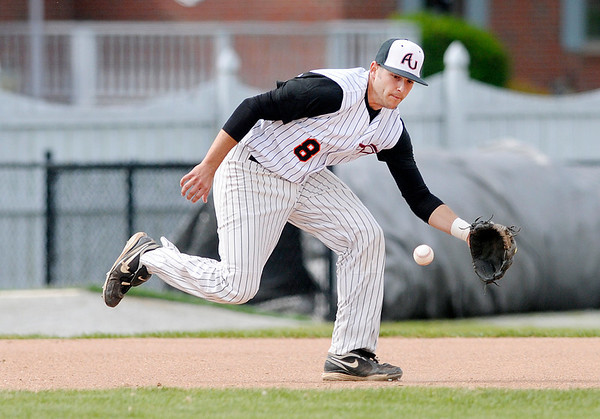 Anderson University third baseman Vince Moore fields the ball as the Ravens  hosted Manchester College on Tuesday.