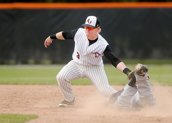 Manchester's Austin Rieke steals second as he beats the throw to Anderson University second baseman Kyle Beckman as the Ravens hosted the Spartans on Tuesday.