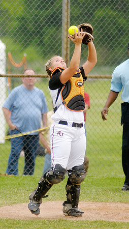 Anderson catcher Stephanie Atkins catches a foul ball behind home plate.