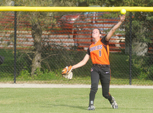 Anderson's Katie Lee throws to her cut off from center field.